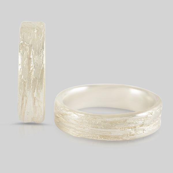 Silber Trauringe Gold versteinerte Holzstruktur